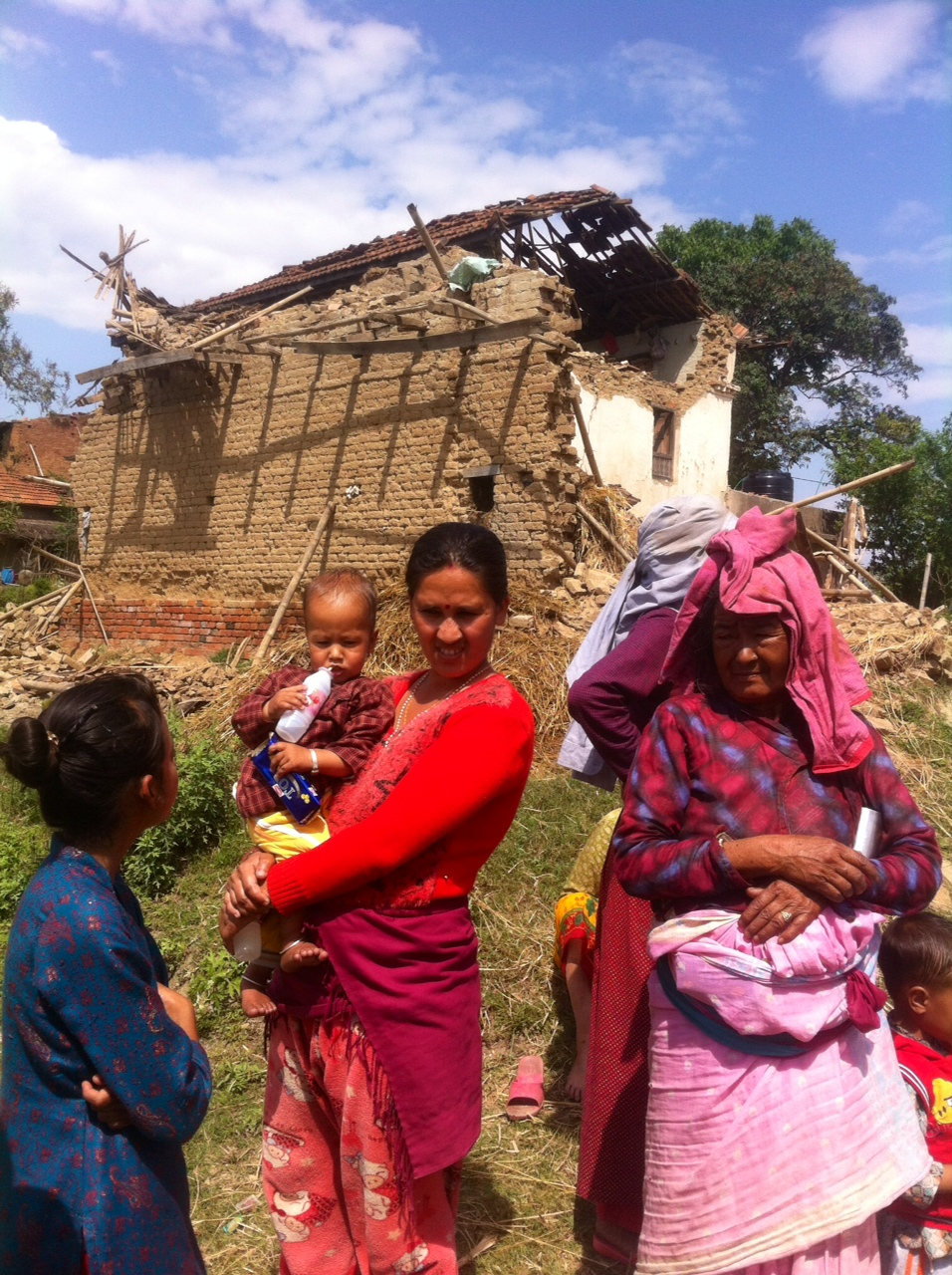 Woman and her newborn in front of their house - Bhaktapur.jpeg
