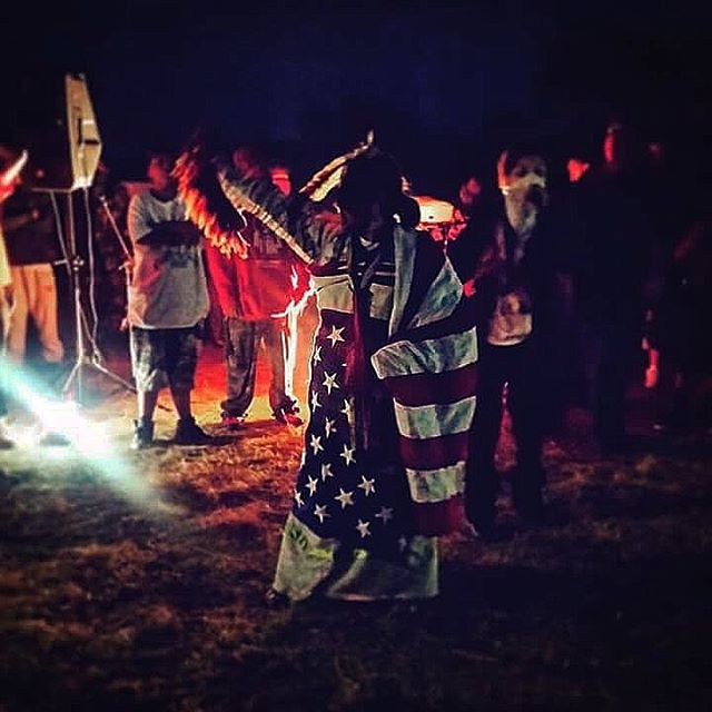 On November 20, 2016 I stood on the Backwater Bridge at Standing Rock with my relatives as we were sprayed by water cannons, sprayed with tear gas and shot with percussion grenades and rubber bullets. I will never forget the cries and the praying all around me. Just days after it was Thanksgiving and I was asked by my camp to help serve Thanksgiving dinner. The camp had swelled to around 14,000 people at that point. A lot of white people had started to come and it was hard to deal with the influx of people and the strain on camp. At one point a white woman asked me where the compost was because she couldn't finish her breakfast, her plate was full. I directed her to our camp compost and she said it was too far. Then while I was serving there were many people asking me if what I was serving was dairy free or if I could give them more. This went on for three hours and I broke down into tears and had to leave. The irony of being Native and serving all of these white people on Thanksgiving right after we were attacked on the bridge. It was too much. A lot of people have asked what I will do for this day. I will fast. I will reflect. I will go out on the land.  But if other Native people have chosen to reclaim this day and celebrate with food and family I am in full support. 📍Standing Rock Sioux Indian Reservation