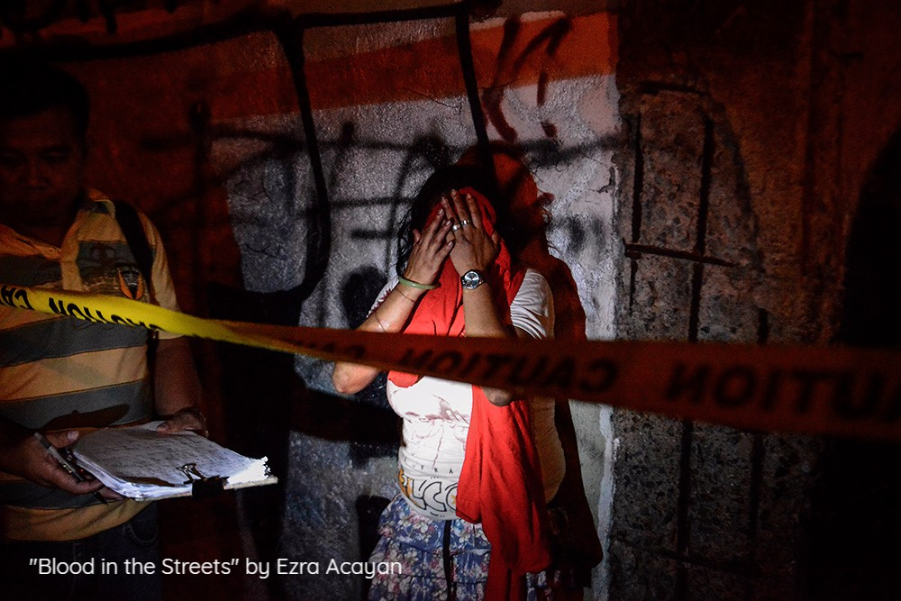 "Drug-related killings continue as President Rodrigo Duterte marks his first year in power. The Philippine National Police has claimed that there have been at least 12,000 killings throughout the country in the past year, 3,000 of which were drug suspects shot dead in police operations. Another 2,000 killings have been confirmed by police to be drug-related while the other 7,000 deaths are still under investigation. Human rights groups have said that many of these killings were carried out by undercover police or state sanctioned death squads. United Nations member states called on the Philippine government to conduct a ""thorough"" investigation into extrajudicial killings in the country and hold accountable the perpetrators. Duterte won the presidency a year ago by pledging to kill thousands in an all-out war against drugs in a country where drugs and crime are deeply-rooted."