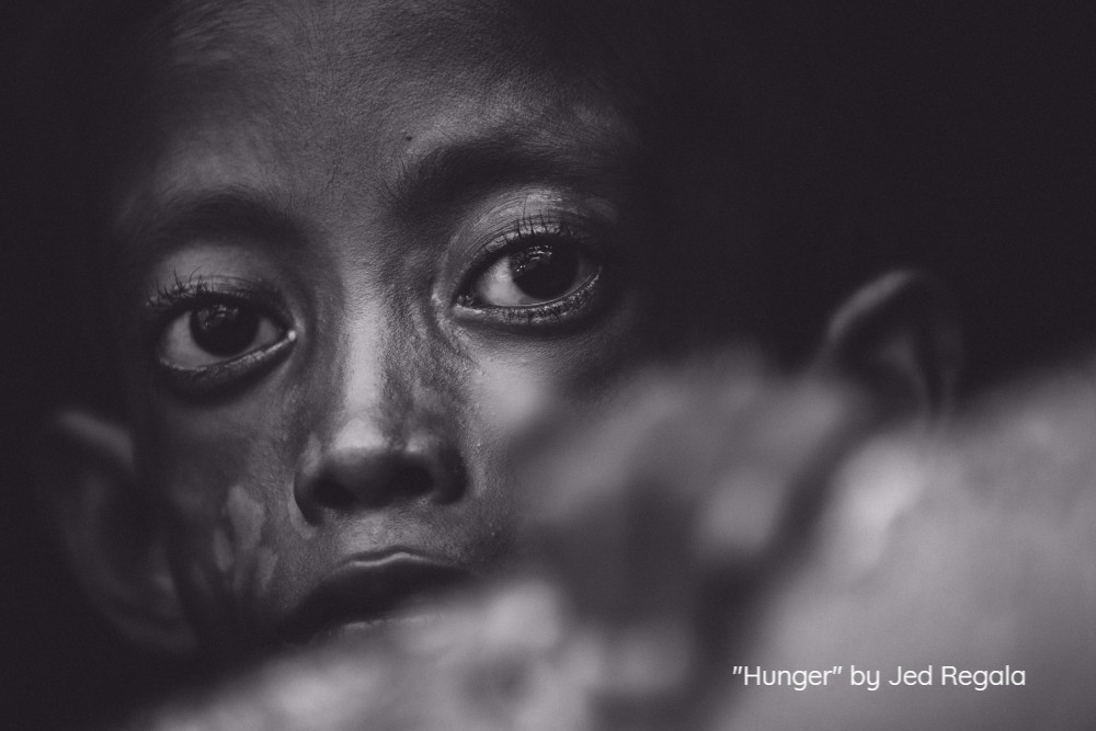 Hunger is one of the biggest global challenges that we are facing today. According to United Nations Food and Agriculture Organisation, it is estimated that 1 out of 9 people or about 795 million people of the 7.3 billion people in the world were suffering from chronic undernourishment in 2014 to 2016. With my team of journalists, we went to a small barangay located in Lucena City, Quezon Province, Philippines. There we met a thirteen-year old boy who became too weak to support his own body, let alone stand. Due to lack of proper nutrition and his body's inability to absorb essential nutrients, the child can only watch from his window as his peers play and run around without a worry in the world. Without any permanent and sustainable employment, his family could not provide even their daily basic needs. But somehow, faith in humanity gets restored. A few months after that visit, help came his way. Food, vitamins, medicine, clean drinking water and necessary aid came in from concerned citizens. Gradually, he is now gaining back his health and hopefully a day will come when he will be able to stand on his own feet again.
