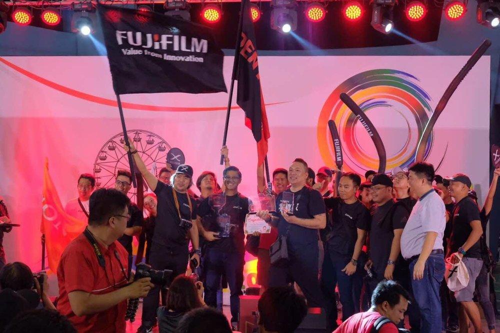 Team Fujifilm celebrating on stage