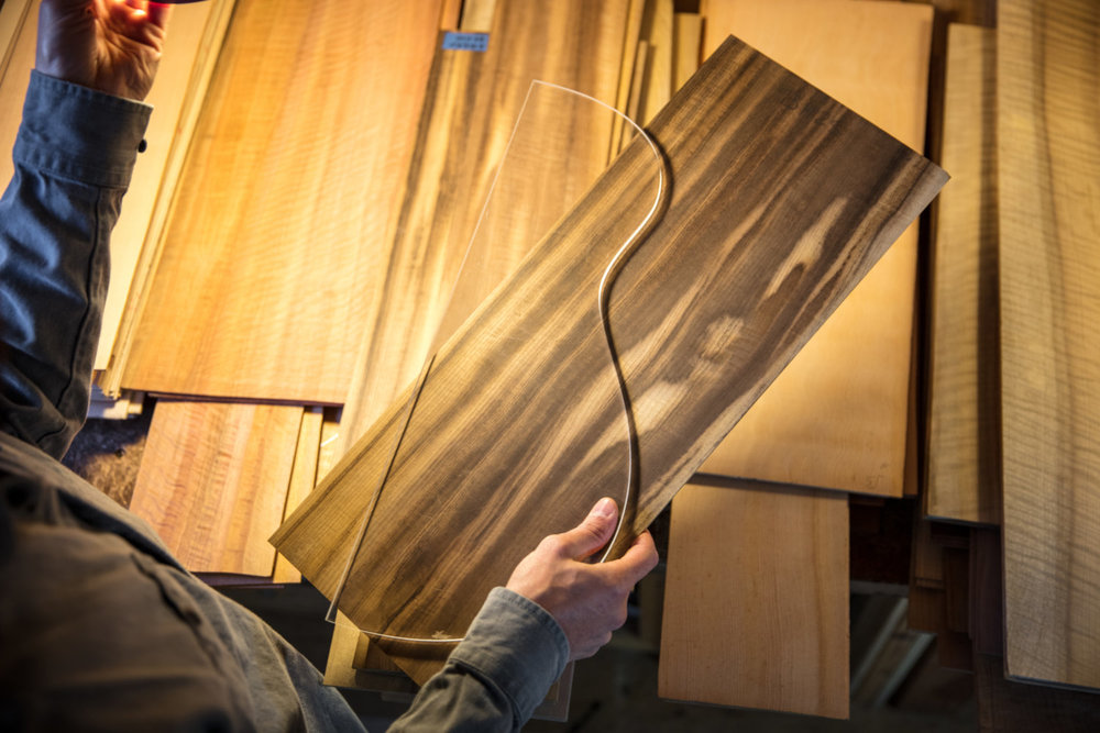 Luthier Mark Gaiero of Gaiero Guitars sorts through a stack of tonewood.