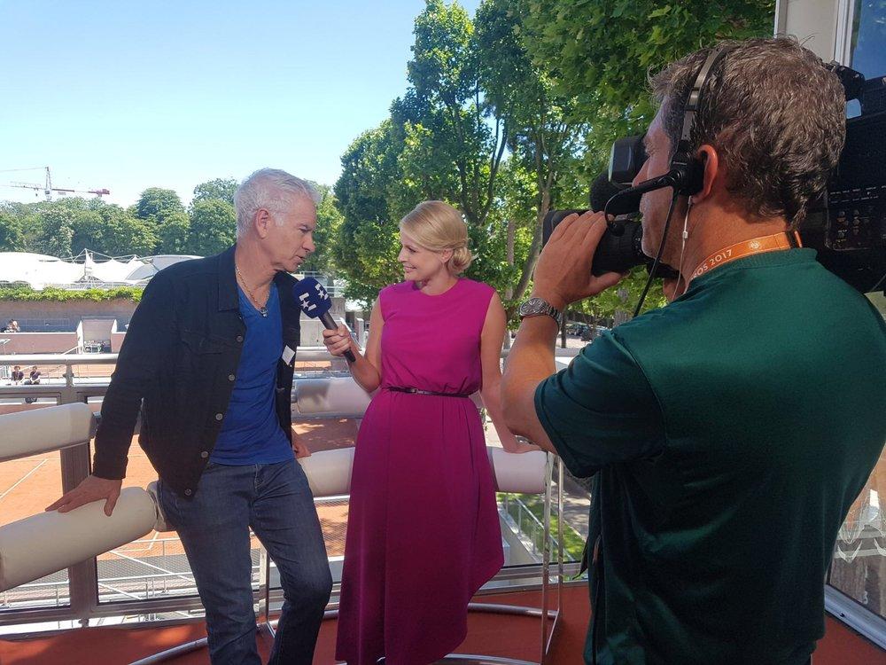 Catherine interviewing John McEnroe for Eurosport