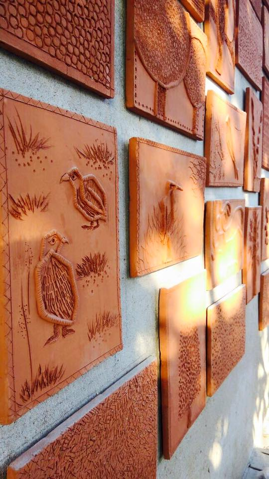 Custom-developed terracotta-tile mural based on Gir flora, fauna and culture