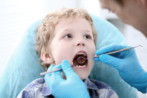 Child having dental examination