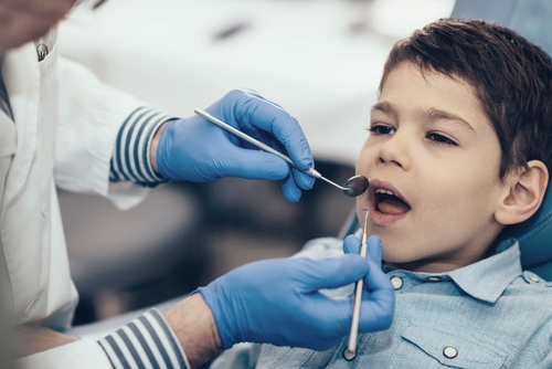 Routine dental check up for boy
