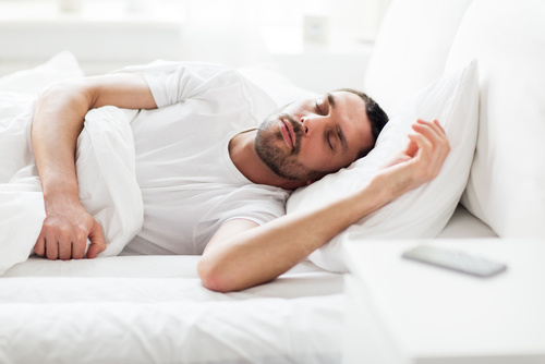 Man sleeping after using Home Teeth Whitening
