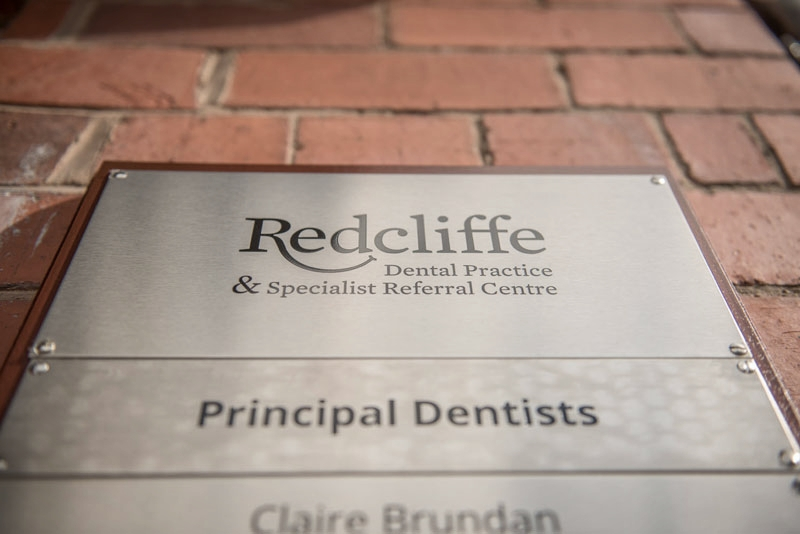 Redcliffe Dentist name sign