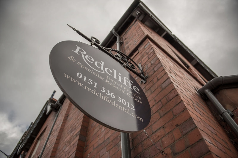 Exterior hanging wall sign for Redcliffe Dental