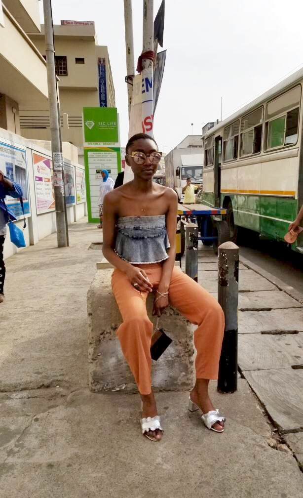 Market Day at SIC in Accra, Ghana  - Pants Cotton blend trousers Tanetema Fabrics, Top (Denim peplum skirt worn as top) Olive Ole, Shoes Vera ruffle slide sandal in silver metallic foil Loeffler Randall