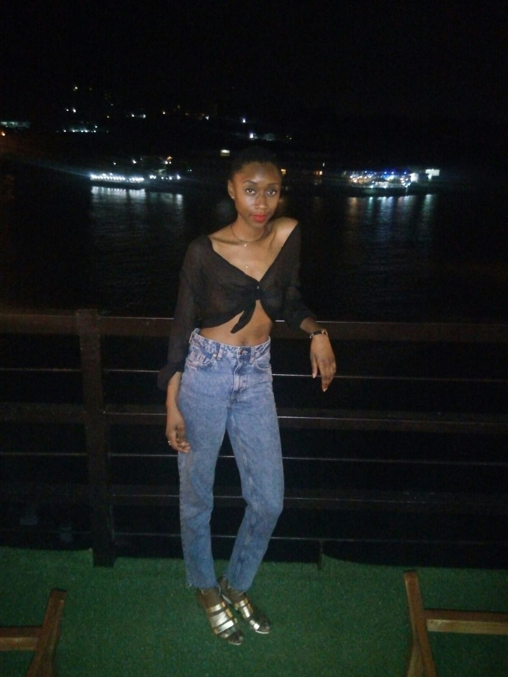 Casino Nights in Freetown, SL - Black Sheer button down Express top thrifted, Cigarette mid-rise cut acid wash denim jeans H&M, Gold leather strappy sandal Loeffler Randall, Fenty red lip stain