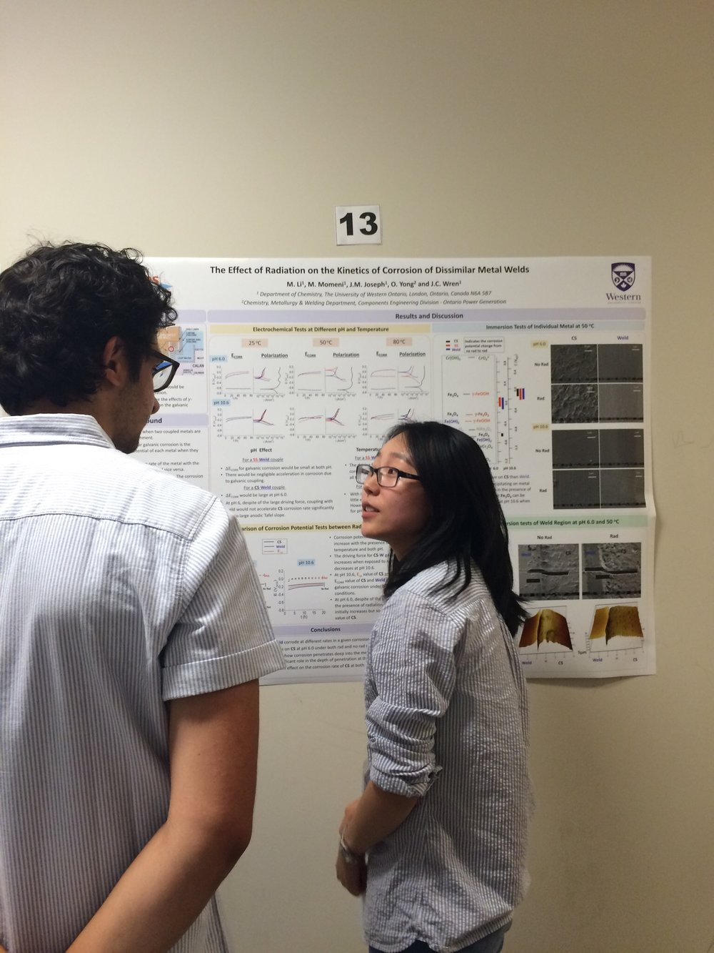 Mi Li presenting her poster at the NACE student conference, 2017.