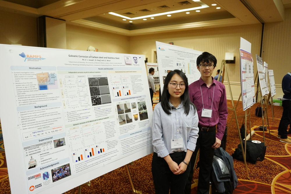 PhD candidates Mi Li and Dan Guo in front of their posters at the UNENE meeting, December, 2017.