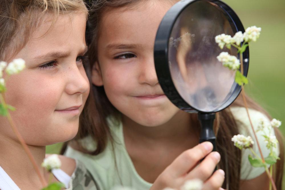 JSLC.2Girls.MagGlass.Botany.AdobeStock_40466943.jpeg
