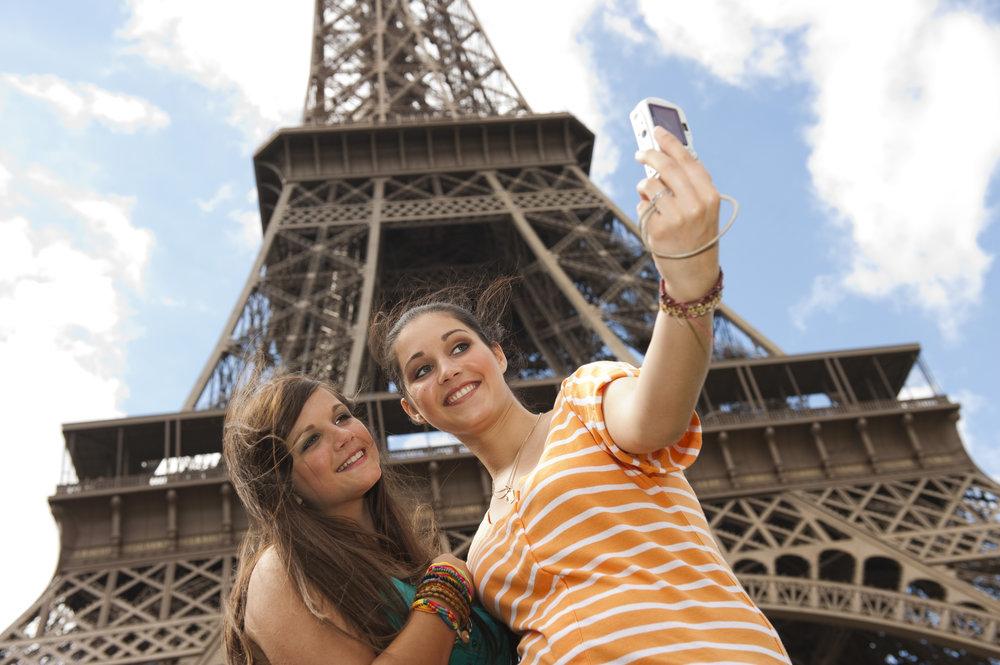 Bilingual.France.2 girls Eiffel Tower. Selfie.AdobeStock_43256228.jpeg