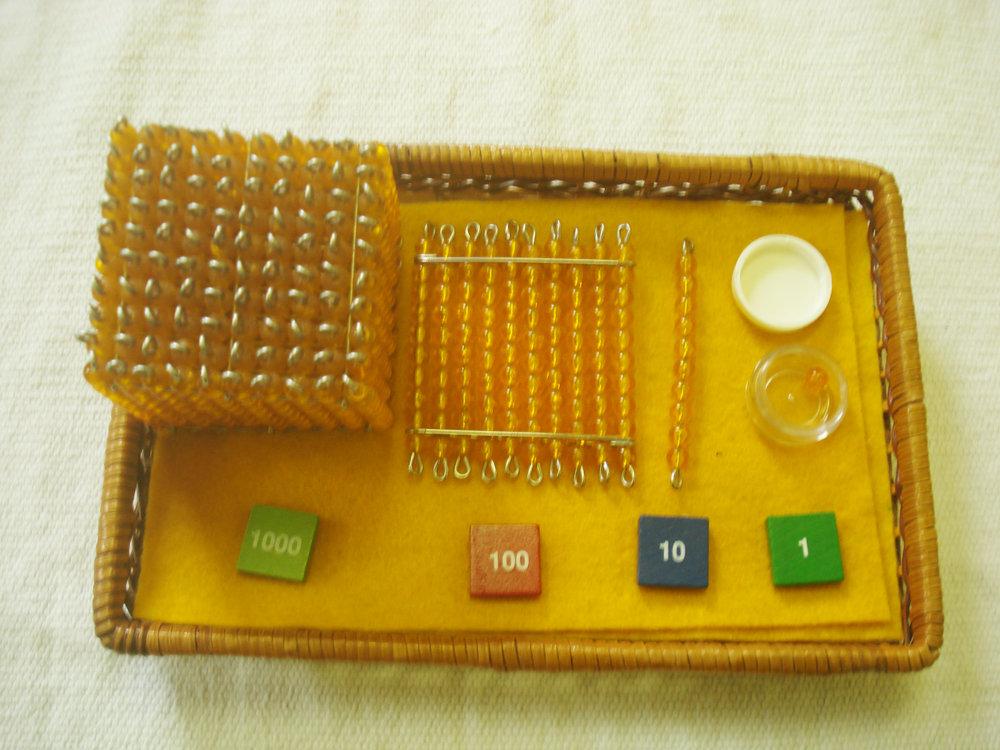 Montessori Math. Golden Beads. Place Value to 1000 First Presentation tray. basket.jpg