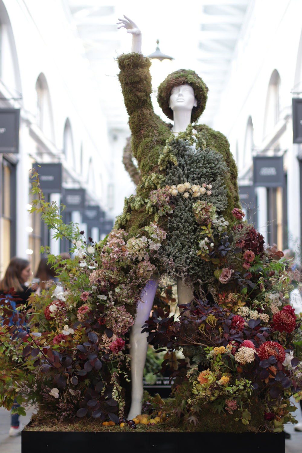 Seasonally dressed mannequin for 'Jardin Blanc' and 'Fleurs de Villes@ at the Chelsea Flower Show in Covent Garden 2018.