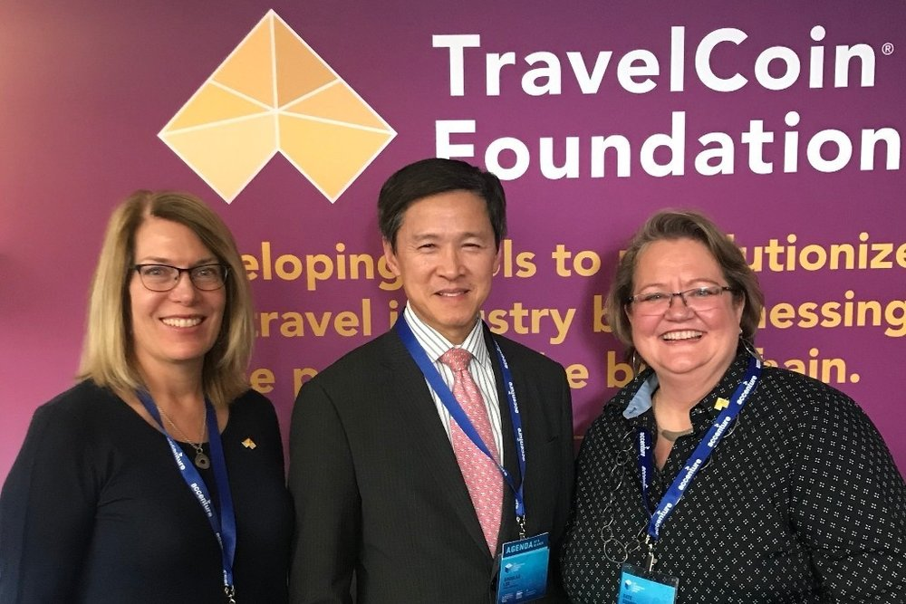 From left to right ( 从左至右: Lisa Salinas, Chief Operations Officer of TravelCoin Foundation; Mr. Douglas Lee, with the Hong Kong Economic and Trade Office; Kate Guimbellot, Executive Director of TravelCoin Foundation.