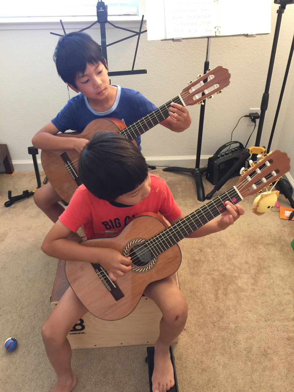 Sean and Noah practicing hard at home