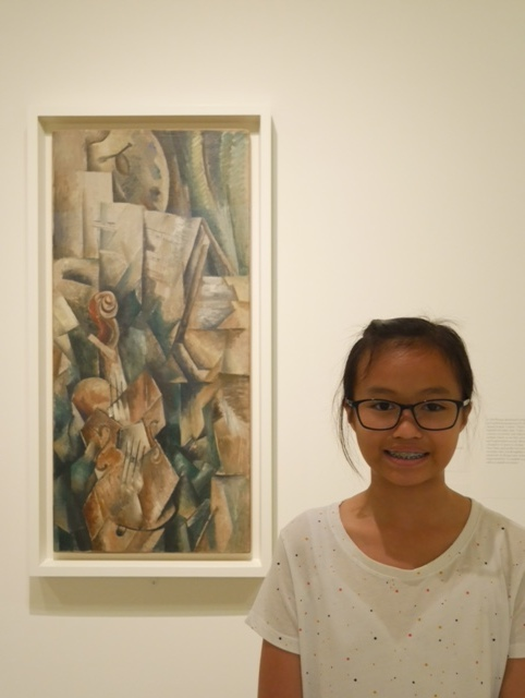 "Ella standing next to Georges Braque's painting titled ""Violin and Palette"""