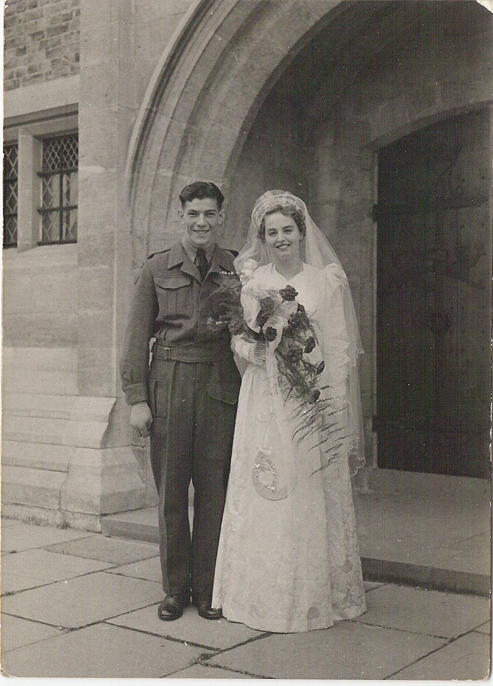 c. 1945. Olive Danyluk and her husband Mike on their wedding day in England during WWII.
