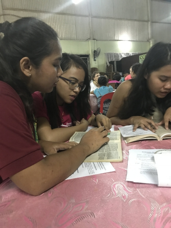 Young Filipinos, trained by teams from HAC, sharing the gospel with their peers.