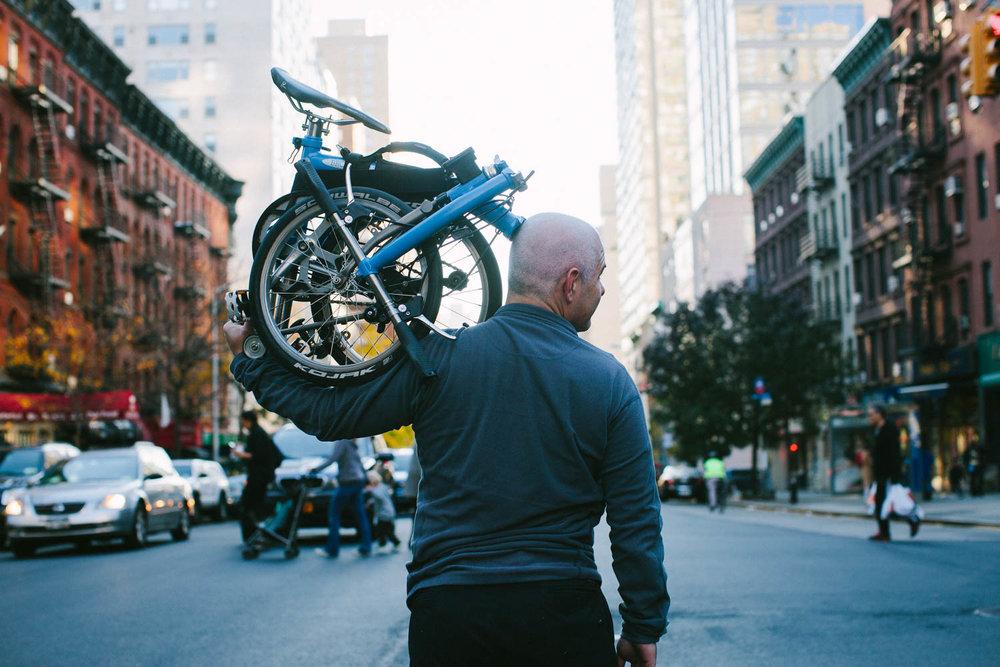 Man with Brompton folding bike, Upper East Side, Manhattan.Canon 5D Mark II, 50mm f/1.2.