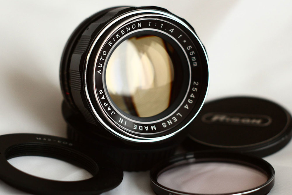 Rikenon 55mm f1.4 by Joel Peregrine. ( source )