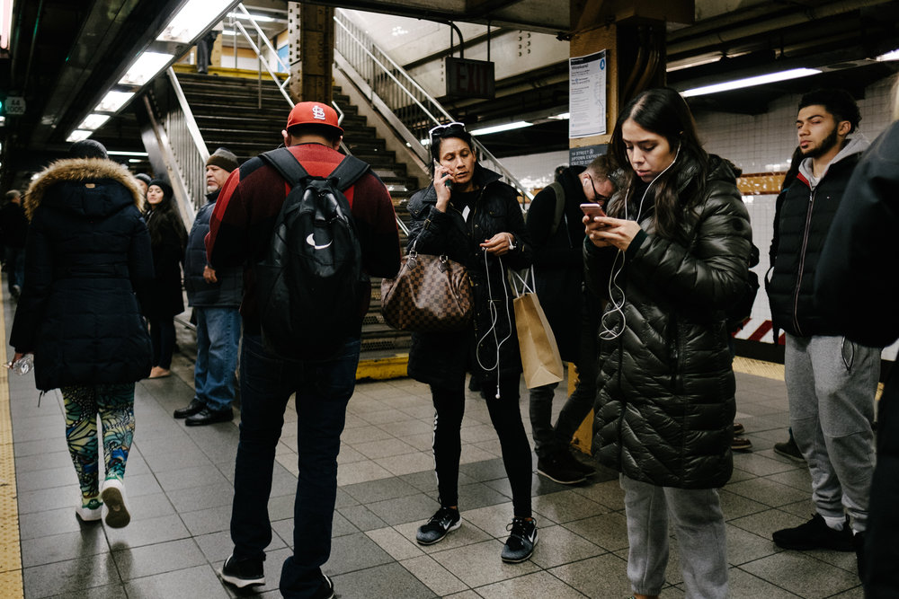 A woman in the 14th street ACE station in Chelsea, Manhattan. Fuji X-pro2, Fuji XF 16mm f/1.4 WR.