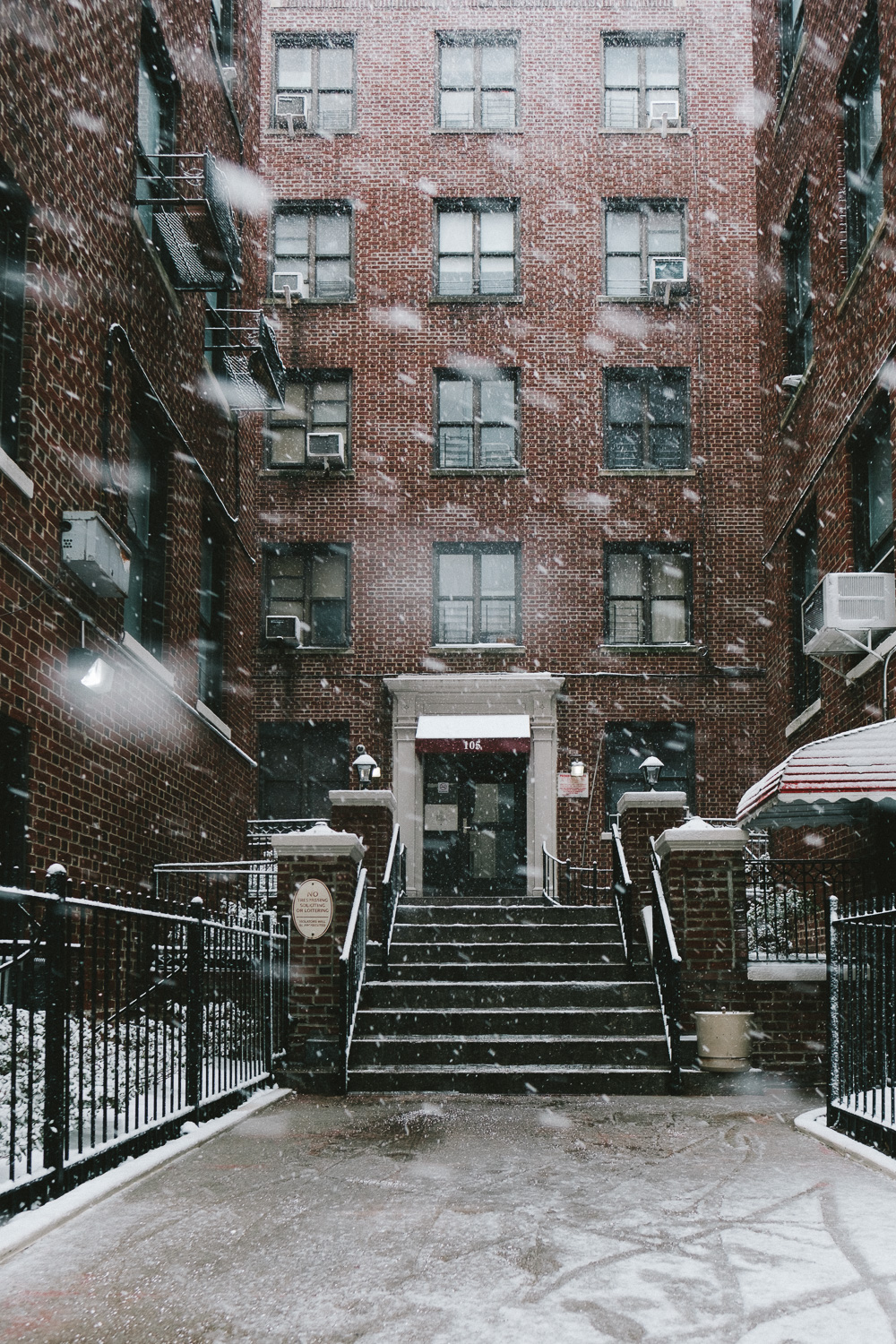 A snowy stoop in Washington Heights, Manhattan.  Fuji X-Pro 2, Fuji 16mm f/1.4.