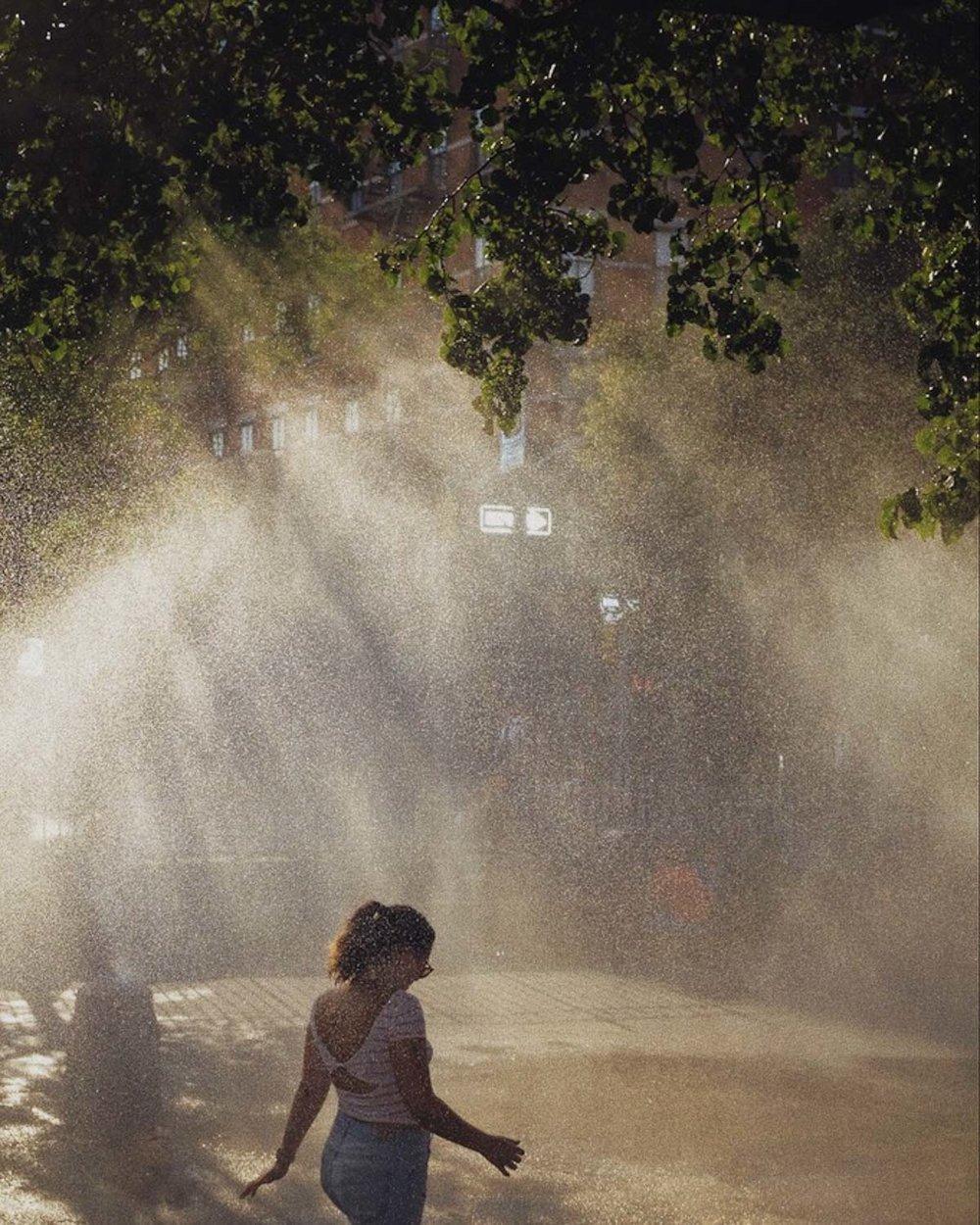 fuji-x100f-photo-walk-summer-nyc-street-shower.jpg