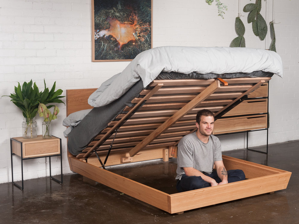 Nathan Lawrence from Heimur showing his confidence in the structural integrity of his multi-functional bed-base by sitting underneath it.