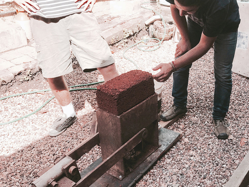 Five Mile Radius' team experimenting with earth construction techniques with their 'The Dirt Temple' project.