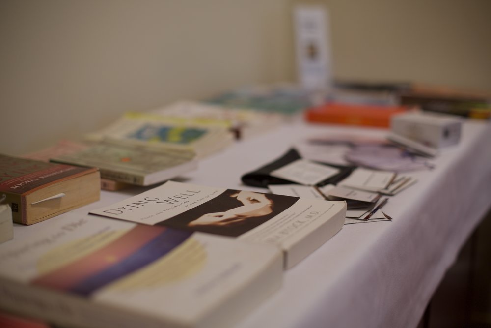 A table full of Helen's book recommendations for dying well.  Photo by Mathew Bate.