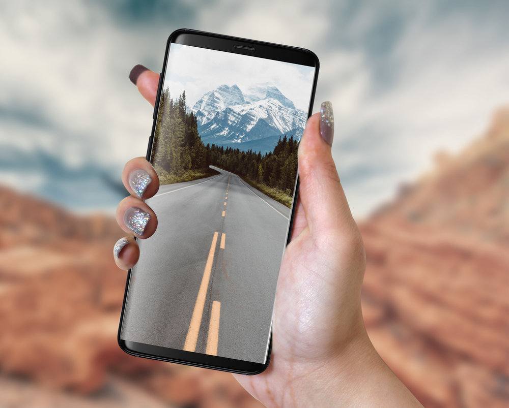 Samsung Galaxy S9 in Hand PSD Mockup.jpg