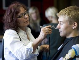 Melanie Melanie applies make-up. Photo: Justice Beitzel