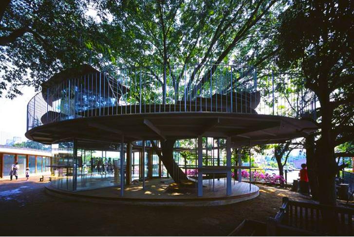 http://inhabitat.com/tezuka-architects-amazing-fuji-kindergarten-wraps-around-a-100-year-old-zelkova-tree/tetzuka-architects-tree-wrapped-classroom-japan-5