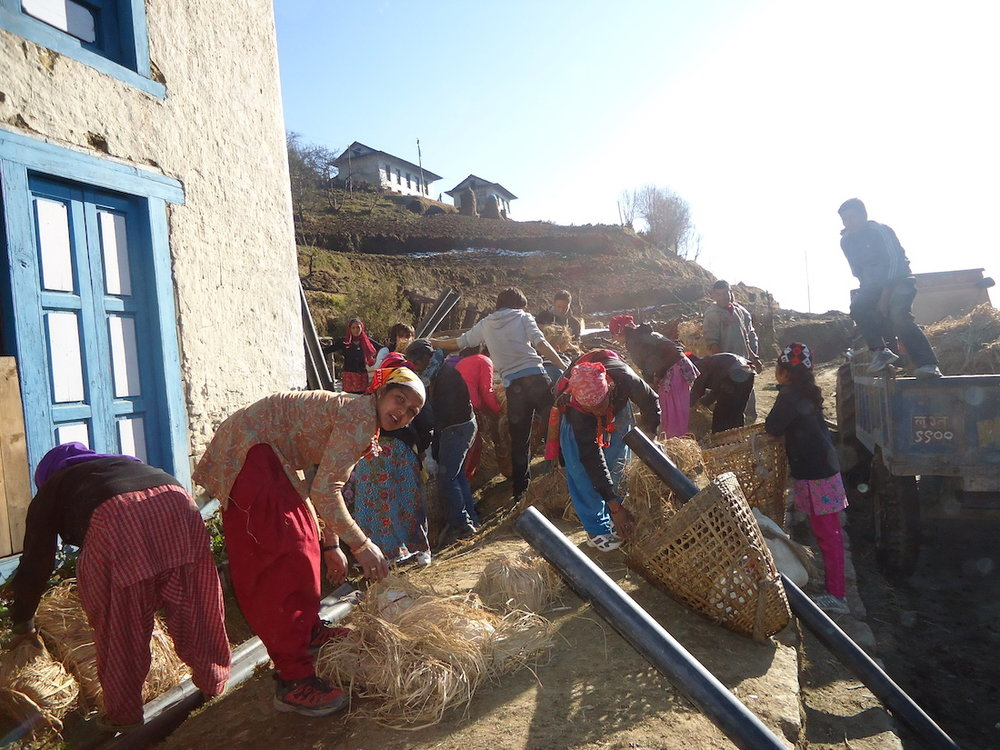 Girls receiving Toilet Construction meterial sm.jpeg