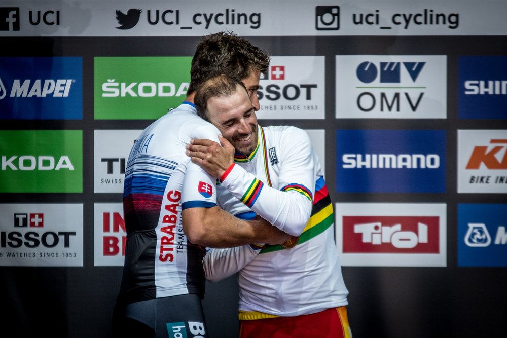 Three time World Champion Peter Sagan hands the rainbow jersey over to 2018 winner, Alejandro Valverde.