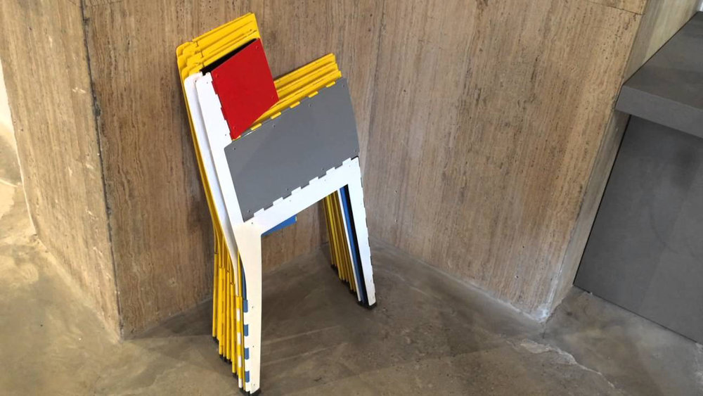 Stitch Chair for Cappellini‭. ‬Adam's goal was to create a version that didn't look like every other folding chair on the market and had the capability to go completely flat‭. ‬Comprised entirely of aluminum‭, ‬the chair bisects along a hinge for an impressively‭ ‬small footprint‭, ‬a mere 15mm wide‭, ‬when collapsed‭.‬