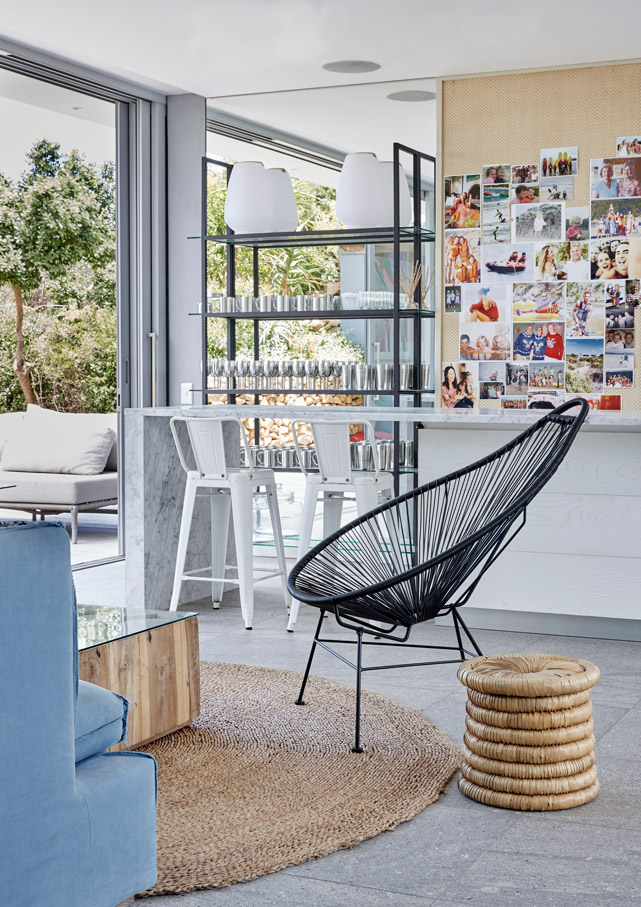A down-to-earth practicality underpins the sophisticated Ibiza Lounge, specially designed as a playful family space. Natural textures and woven grass mats offset the cool stone floors, and all seating – from the classic '50s-style Acapulco chair to the Tolix bar stools – welcomes wet swimsuits. Find a similar bamboo coiled ottoman at Weylandts.