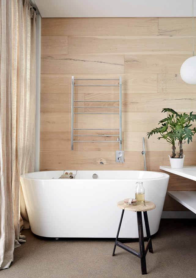 The pale wood wall lends this en-suite bathroom a stripped-back, Scandi-style appeal. Each of the bedrooms has an indoor bathroom with deep tub and an outdoor shower.
