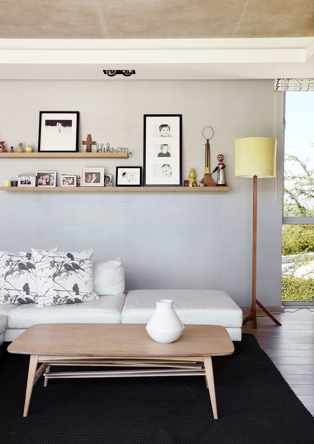 The white leather sofa from Klooftique was purchased before the house was built on the advice of Jan-Heyn‭, ‬with an eye to how it‭ ‬might suit the house when complete‭. ‬The vintage coffee table is from Space For Life‭. ‬The Scandinavian mid-century wooden toys are design classics‭, ‬and include Kristian Vedel‮!&‬s family of birds and Kay Bojesen‮!&‬s iconic monkey‭, ‬which Matt‮!&‬s father has had since he was a child‭.‬