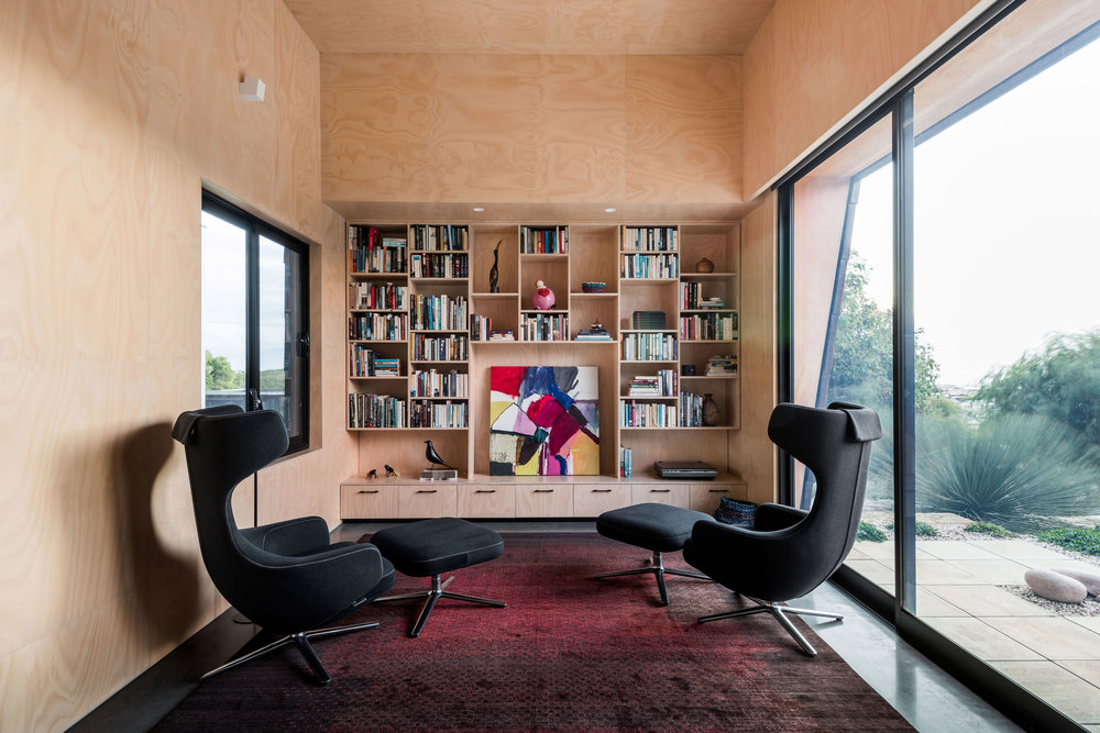 "The hoop pine cladding of the library provides a cocoon-like quality further emphasised by the Antonio Citterio-designed chairs‭ ‬that envelop the sitter‭. ‬""Flooded with northern sun in winter the library is a wonderfully warm space in the winter""‭.‬"