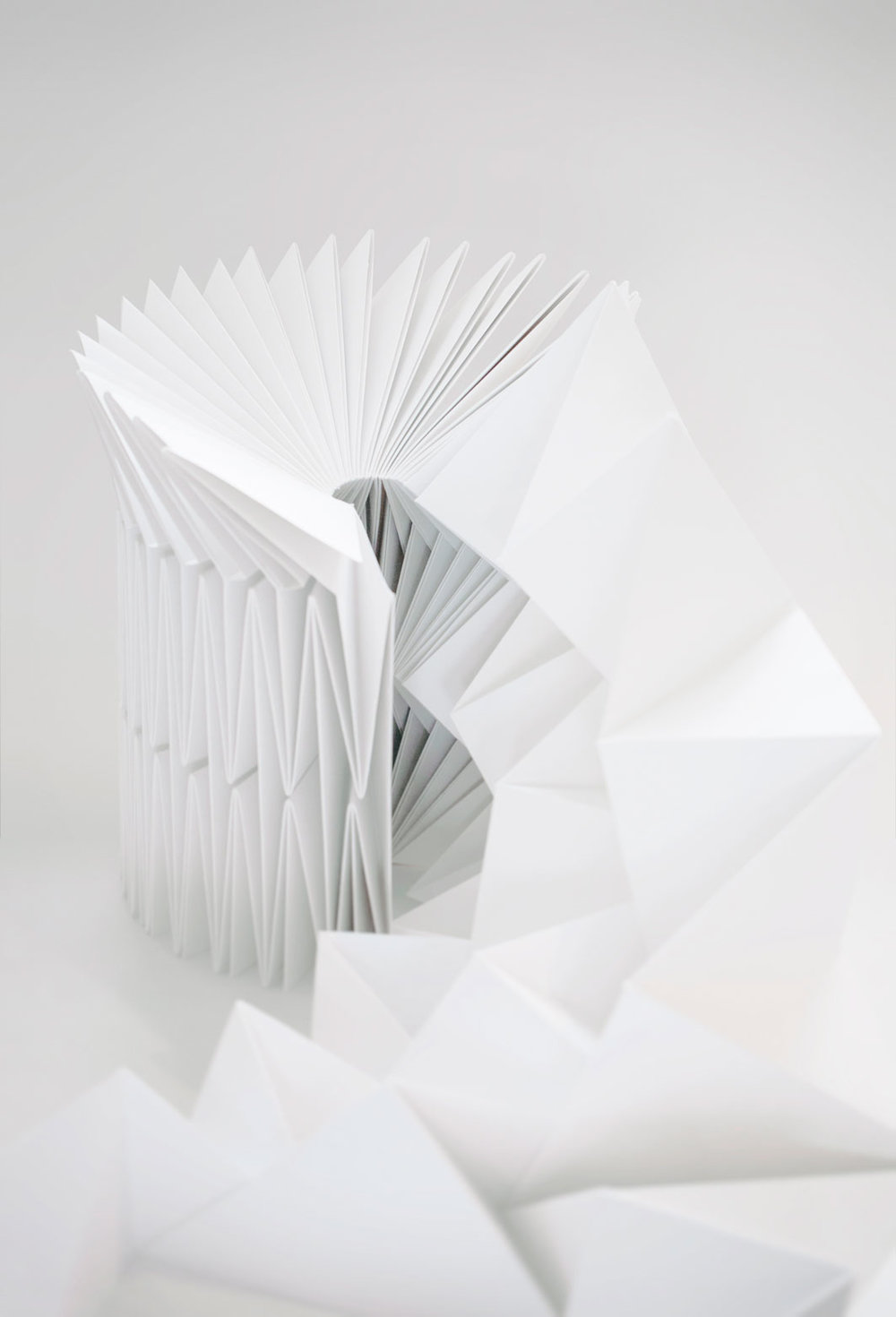 SA seat in paper folded as tessellations‭. ‬Construction interlocks‭. ‬Nine meter handfolded paper‭. ‬2010