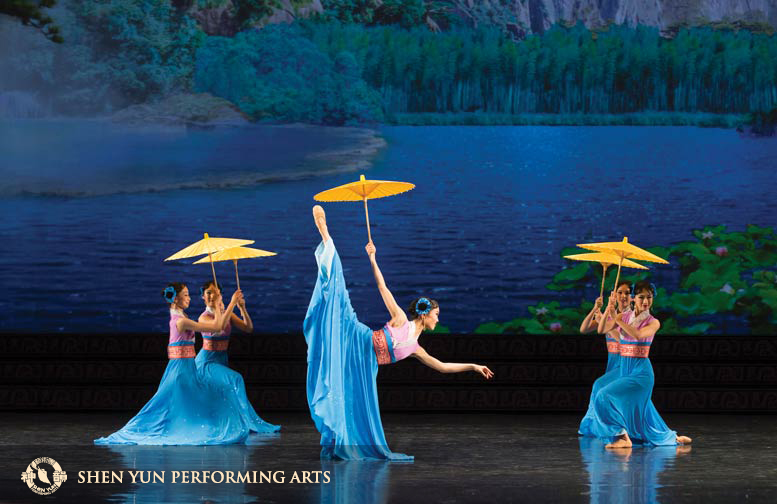 Above: In Umbrellas, moon fairies use their magic to shelter themselves with umbrellas during a brief earthly visit to a mountain lake. Opposite: Despite a rigorous touring schedule, Zhou enjoys nothing more than performing and exhilarating audiences around the world.(c) copyrighted by Shen Yun Performing Arts