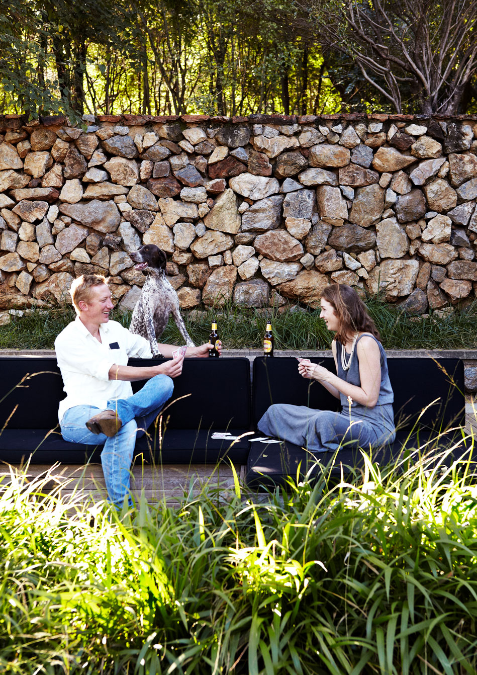 Lee and Lauren enjoy sundowners on the deck‭, ‬an outdoor entertainment and relaxation area that Lee sees as a modern reinterpretation of the traditional stoep or verandah‭, ‬where traditionally much outdoor entertaining and leisure time is spent in South Africa‭.‬