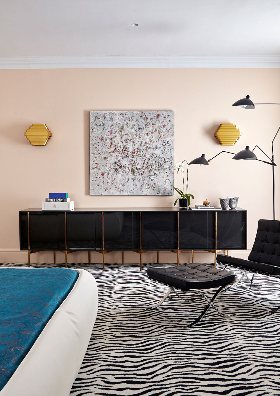 In the master bedroom, the custom made sideboard is by Tonic in Johannesburg and the standing lamp by Serge Mouille. Hand printed zebra carpets, custom made by Rowley & Hughes, are in all the bedrooms. 'Animal skin is one of my obsessions,' says Andrea.