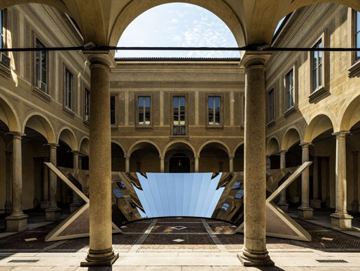 Located in the 16th-century courtyard and garden of Milan's Palazzo Isimbardi, Phillip K Smith lll's Open Sky is a site-specific work designed to offer each visitor a unique experience that changes depending on time and location. It consists of a concrete shell with 34 stainless steel, mirrored panels angled to reflect the sky. 