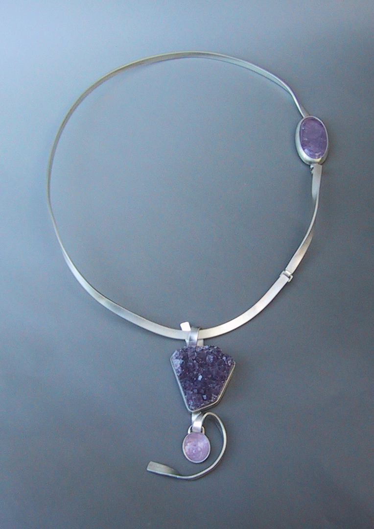 Calligraphy, neckband Handformed Sterling Silver set with natural hued Amethyst crystal druzy, domed and tablecut cabochons. Featuring a hidden hinged clasp. In private collection